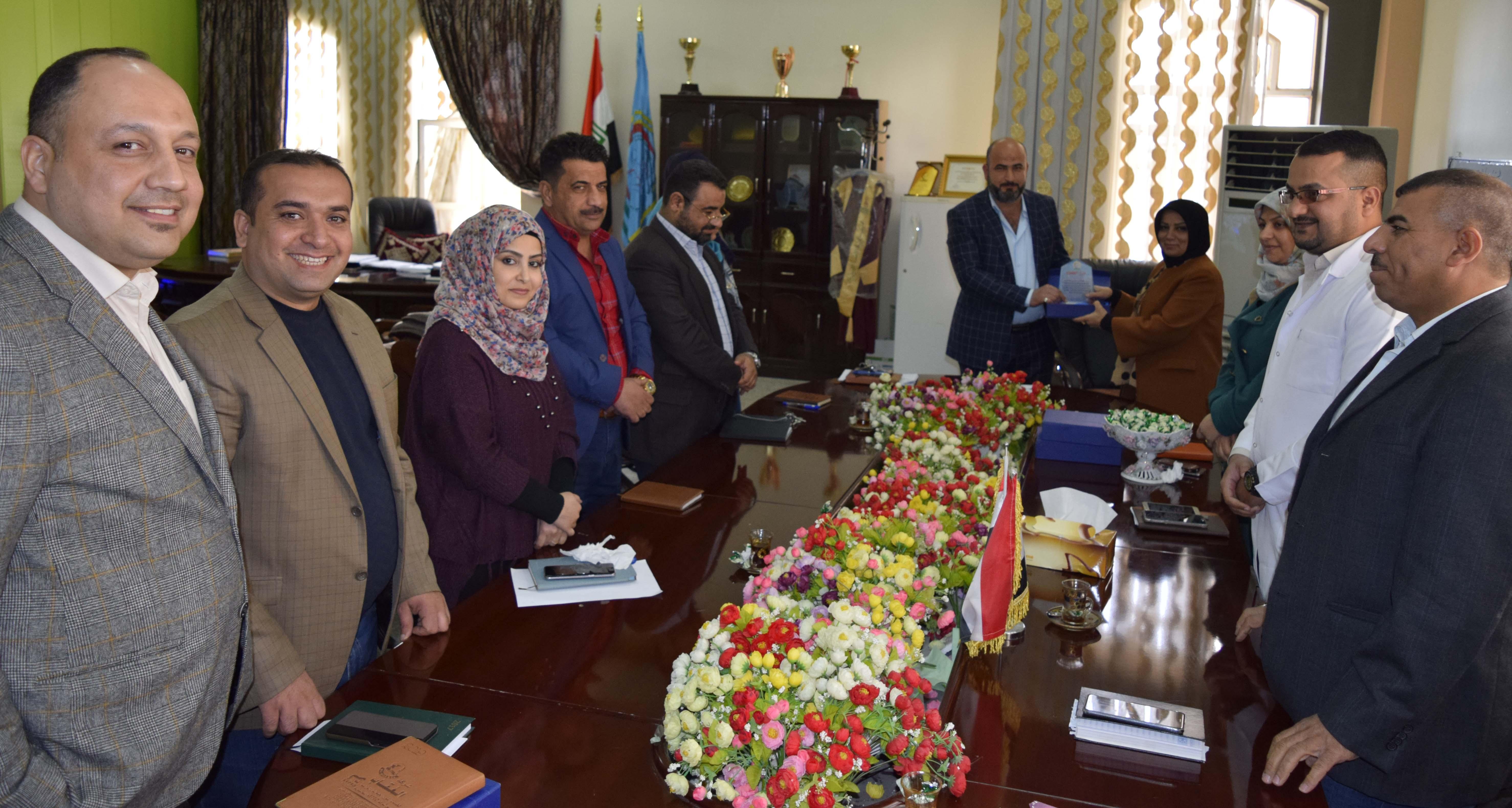 جانب من تكريم السيدة عميد كلية الطب البيطري الاستاذ الدكتورة وفاق البازي للسادة التدريسيين بمناسبة حصولهم على ترقية علمية
